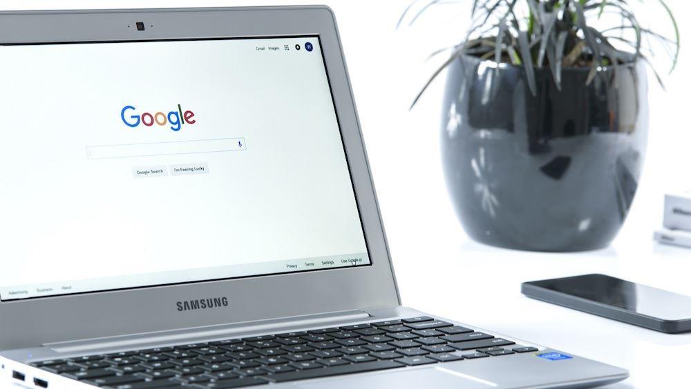 Google search bar open on silver laptop